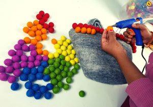 Gluing the felt balls